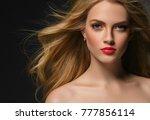 long curly hair blonde woman... | Shutterstock . vector #777856114