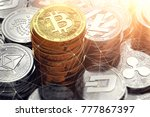 golden bitcoin pile and other... | Shutterstock . vector #777867397