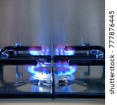 Small photo of Two gas rings alight on a modern brushed steel hob.