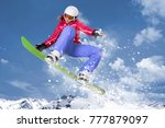snowboarder in red jacket and... | Shutterstock . vector #777879097