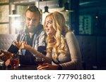 evening at the bar. romantic... | Shutterstock . vector #777901801