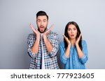 portrait of two young surprised ... | Shutterstock . vector #777923605