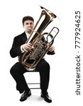 Small photo of Tuba brass instrument. Wind classical musician isolated on white horn player trumpeter