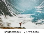 traveler with backpack hiking... | Shutterstock . vector #777965251