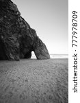 Small photo of Beautiful natural rock arch formation in Adraga beach in Portugal