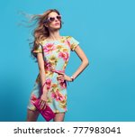 fashion young woman in floral... | Shutterstock . vector #777983041
