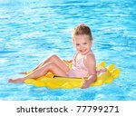 Child  On Inflatable Ring In...