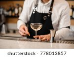 barman dressed in a white shirt ... | Shutterstock . vector #778013857
