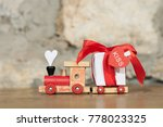 toy locomotive with gifts on... | Shutterstock . vector #778023325