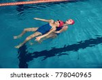two girls in a pool rescue... | Shutterstock . vector #778040965