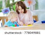 cute little boy drawing and... | Shutterstock . vector #778049881