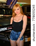 Small photo of MANILA, PH - NOV. 30: Unidentified Kurin female model at Manila Auto Salon on Nov. 30, 2017 in Manila, Philippines. Manila Auto Salon is a annual gathering exhibit for automotive aftermarket industry.