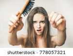 woman with hair comb loss ... | Shutterstock . vector #778057321