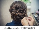 the hands of the hairdresser do ... | Shutterstock . vector #778057879