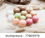 Colorful macaroons on a table with cones - stock photo