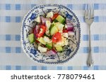 greek salad in pretty blue and...
