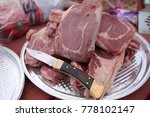 raw steaks on the plate | Shutterstock . vector #778102147