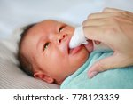 mother use finger to clean baby ... | Shutterstock . vector #778123339