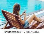 happy smartphone woman relaxing ...   Shutterstock . vector #778140361