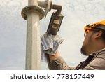 a male technician doing... | Shutterstock . vector #778157449