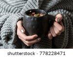 herb tea in black ceramic cup ... | Shutterstock . vector #778228471
