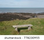 Wooden Bench On The Top Of...