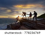 male and female hikers climbing ... | Shutterstock . vector #778236769