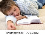 boy learning on the floor | Shutterstock . vector #7782502