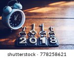 alarm clock and word 2018 on...   Shutterstock . vector #778258621