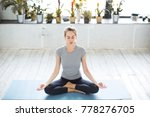 young woman meditates while... | Shutterstock . vector #778276705