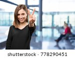 young pretty woman number sign | Shutterstock . vector #778290451