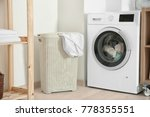 basket with laundry and washing ... | Shutterstock . vector #778355551