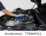 hand cleaning car engine with...   Shutterstock . vector #778369411