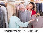 two cheerful young women... | Shutterstock . vector #778384084