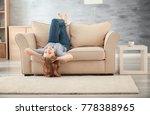 beautiful woman resting on sofa ... | Shutterstock . vector #778388965