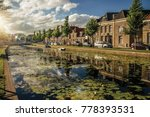 tree lined canal with aquatic... | Shutterstock . vector #778393531