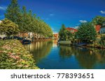 Wide Canal With Houses And...