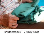 Small photo of Folding the clothes