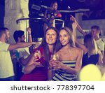 smiling females friends with... | Shutterstock . vector #778397704