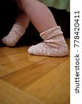 child's foot in a knitted sock... | Shutterstock . vector #778420411