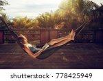 woman with book in her hands is ... | Shutterstock . vector #778425949