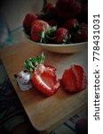 juicy cut strawberry.... | Shutterstock . vector #778431031