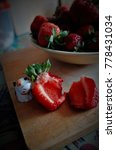 juicy cut strawberry.... | Shutterstock . vector #778431034