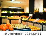 Small photo of Grocery department in supermarket with variety of fruit and vegetables
