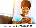 portrait of young woman holding ... | Shutterstock . vector #778484557