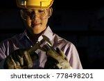 man holding metal with vernier... | Shutterstock . vector #778498201