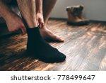 the man wears black socks. men... | Shutterstock . vector #778499647