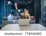 smiling asian woman talking on... | Shutterstock . vector #778546585