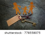 paper family of three with gold ... | Shutterstock . vector #778558075