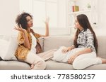 two happy young female friends... | Shutterstock . vector #778580257